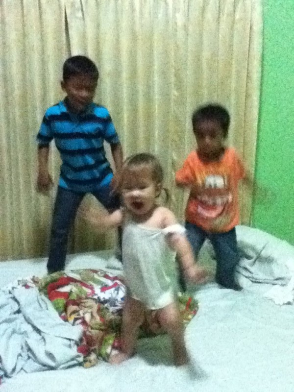 Blurry picture of Lyla playing with her friends Rain and Ruen! PURE JOY!