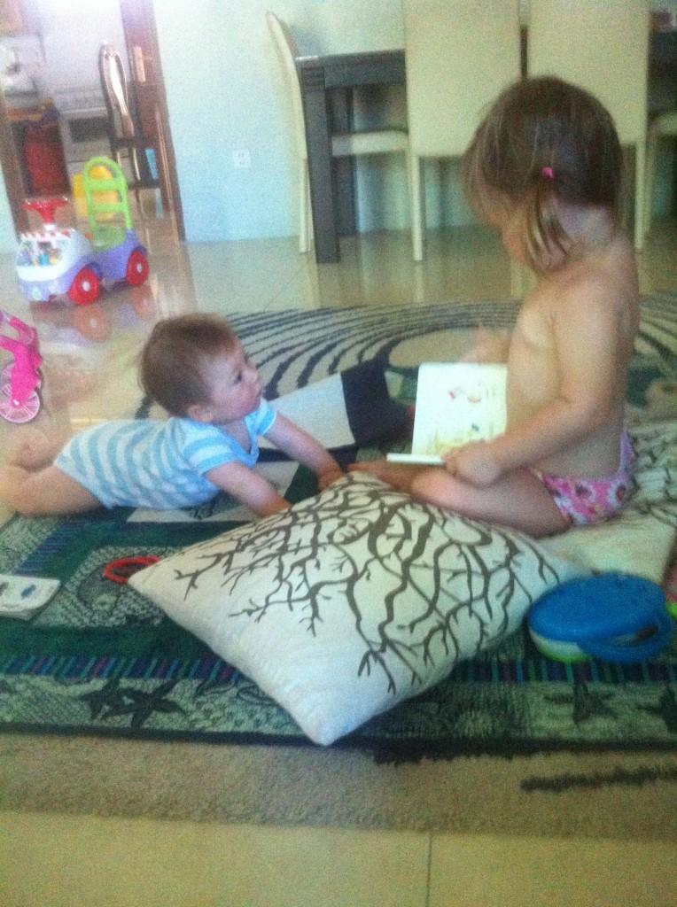 """Lyla loves """"reading"""" to Gunner"""