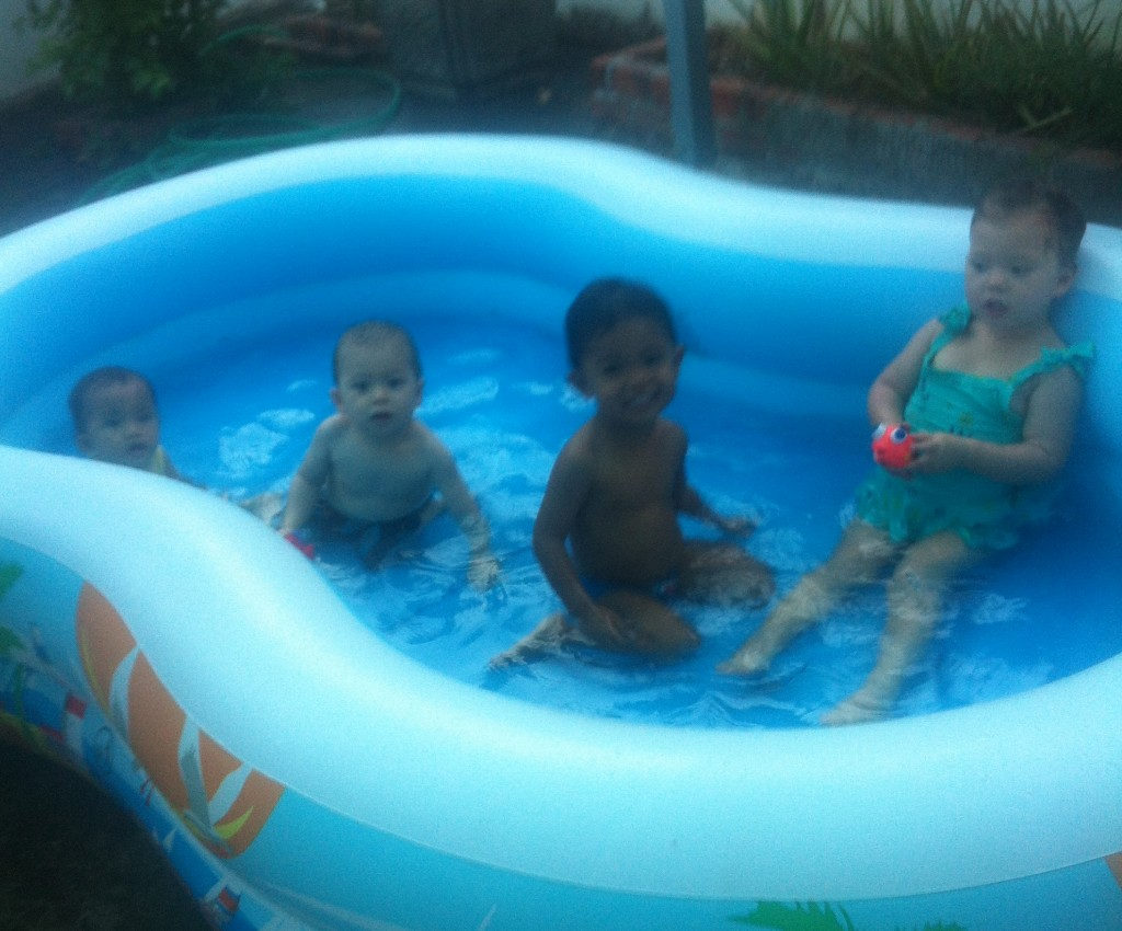 Lyla, Gunner and their friends Visal and Chantrea swimming in our yard
