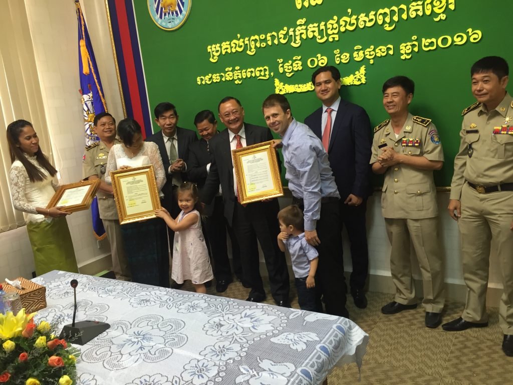 Garth, Lyla and Gunner receiving the Cambodian citizenship in June. I, Caroline, have not been in Cambodia long enough like Garth but will be eligible in about a year's time).